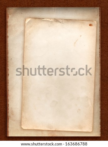 Stack of old photo paper back side grunge with space for text or image  isolated with clipping path on dark brown cardboard background - stock photo