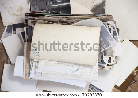 Stack of old photos with turned up photo for your image or copy. - stock photo