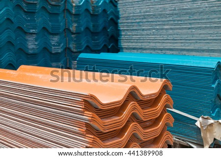Stack of old roof tiles in warehouse - stock photo