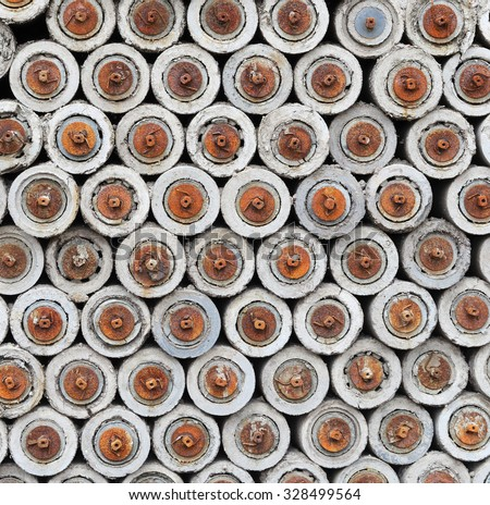 Stack of old rusty conveyor rollers - stock photo