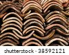Stack of old tiles on a French house renovation site - stock photo