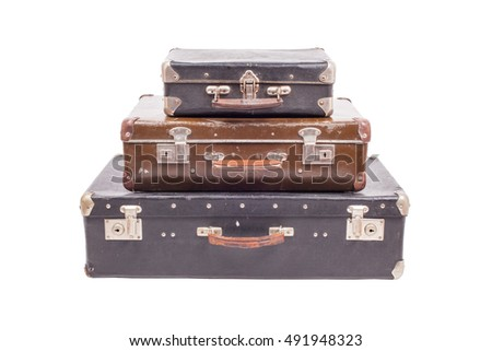 Stack of old vintage suitcases isolated