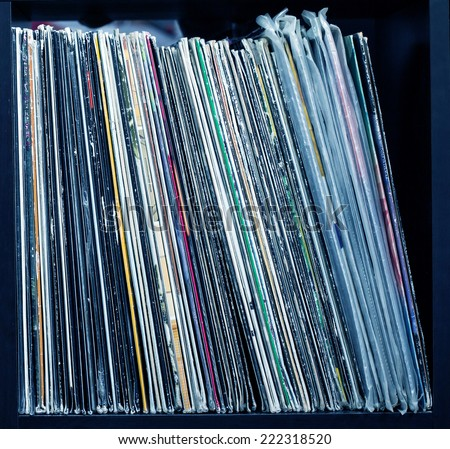Stack of old vinyl records. blue tone - stock photo