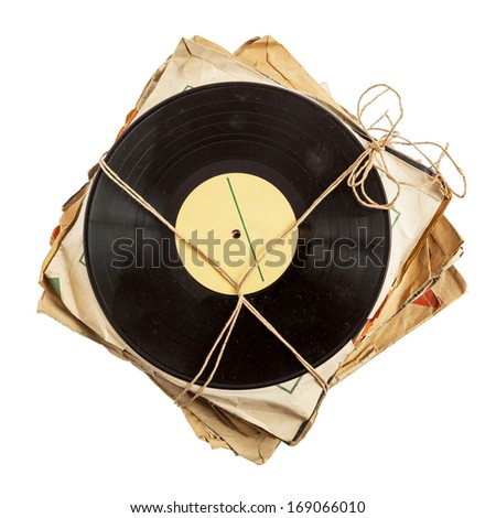Stack of old vinyl records in paper covers  - stock photo