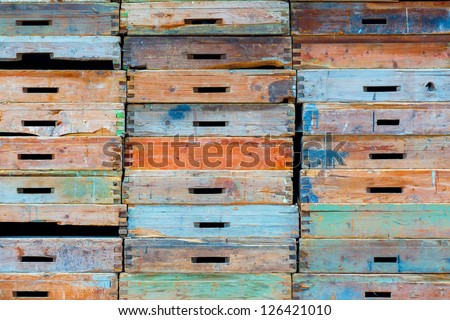 Stack of old wooden drawers painted in different colors - stock photo