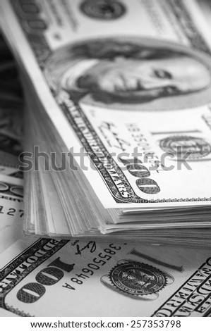 Stack of one hundred dollar bills close-up. B&W. - stock photo