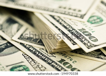 Stack of one hundred dollar bills close-up. (shallow DOF)