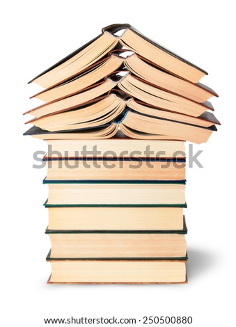 Stack of open and closed old books isolated on white background - stock photo