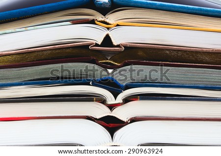 stack of open books background