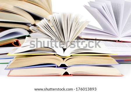 Stack of open books on a white background.