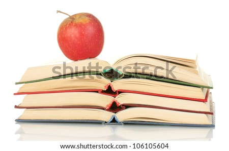 stack of open books with apple isolated on white - stock photo