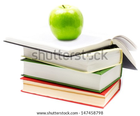Stack of open books  with green apple on white background. Back to school concept. Closeup - stock photo