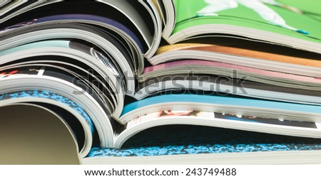 stack of open magazines - stock photo