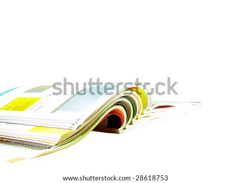 Stack of open magazines isolated over white background - stock photo