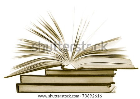 Stack of opened and closed books on white background. Toned image.