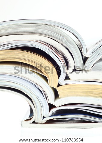 stack of opened magazines isolated on white - stock photo
