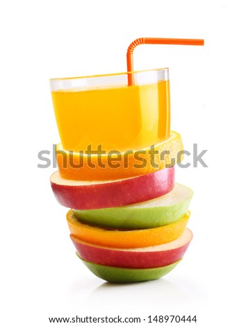 Stack of orange fruit and apples slices with juice. - stock photo