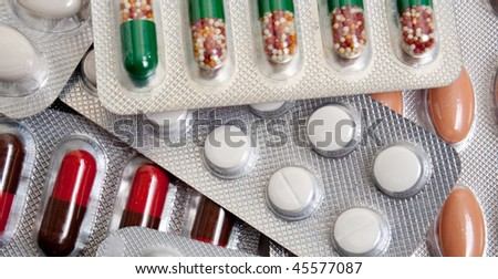 stack of packs with pills. background