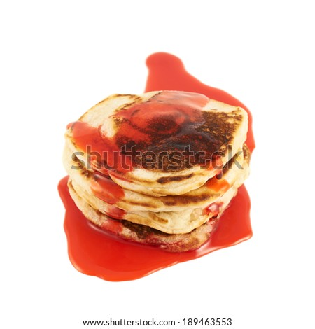 Stack of pancakes covered with the red syrup isolated over the white background