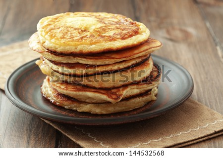 Stack of pancakes on vintage white wooden background - stock photo