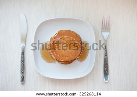 Stack of pancakes with  maple syrup, top view - stock photo
