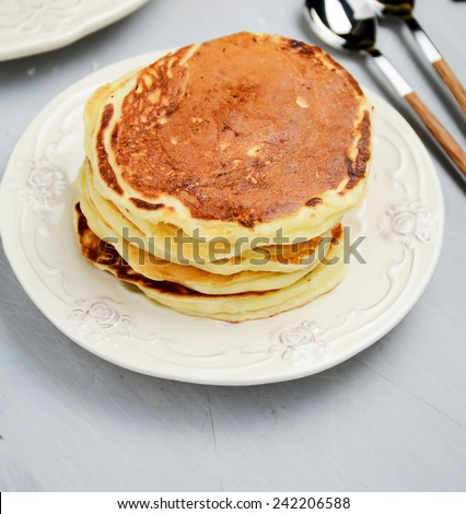Stack of pancakes without toppings, view from above