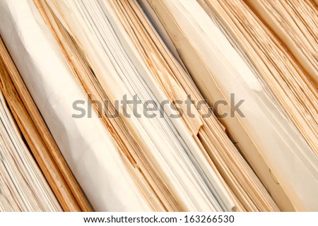Stack of paper documents in archive - stock photo