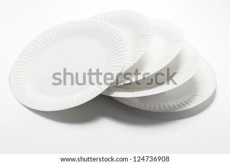 Stack of Paper Plates on Seamless Background - stock photo