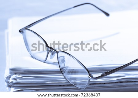 Stack of papers and glasses