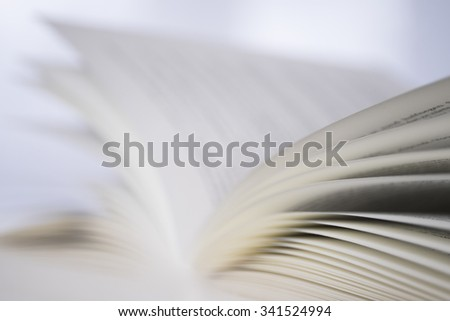 Stack of papers in a book with with shallow depth of field