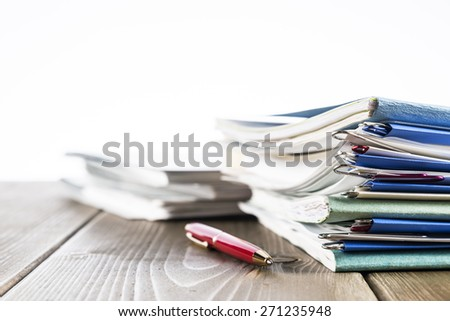 Stack of papers paperwork. Office supply on blank office desk table. - stock photo