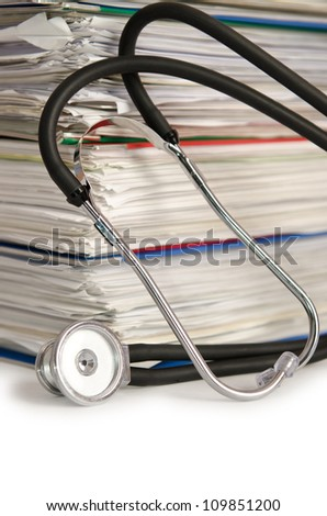 Stack of papers with stethoscope - stock photo