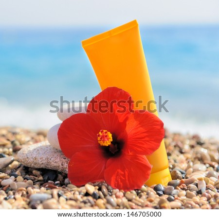 Stack of pebbles, cream and flower - stock photo