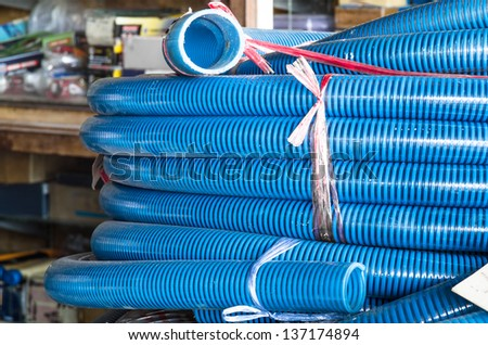 Stack of plastic Tubular Pipes - stock photo