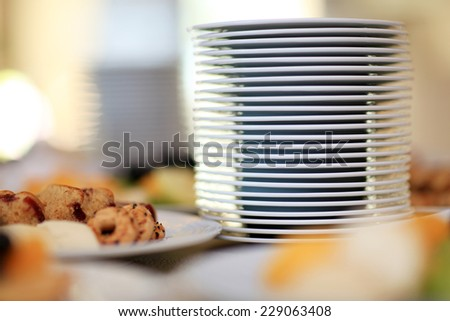 Stack of plates on table. Breakfast food. Shallow DOF - stock photo