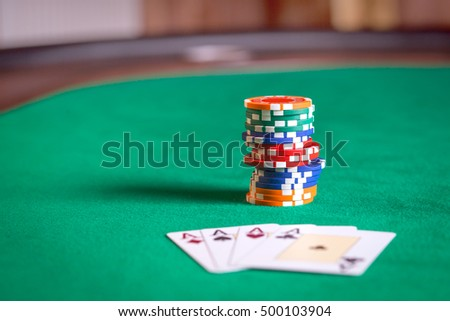 Stack of poker chips and playing cards