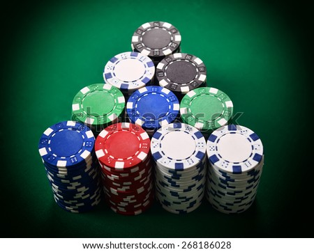 stack of poker chips on green table