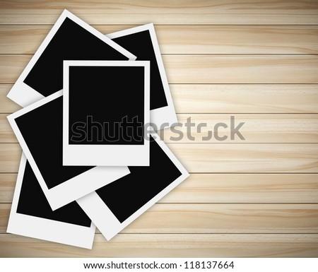stack of polaroid photo on wood background - stock photo