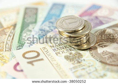Stack of polish coins on cash - stock photo