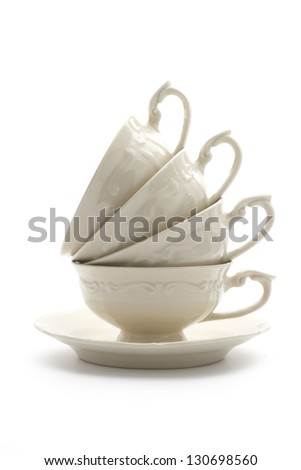 stack of porcelain teacups isolated on white background - stock photo
