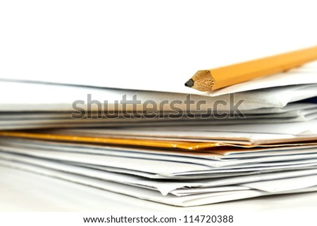 Stack of postal mail with yellow writing pencil on white background. - stock photo