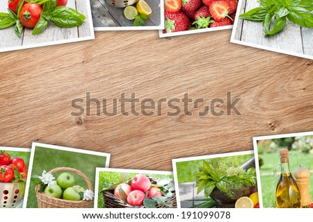Stack of printed pictures collage on wooden table with copy space for your text or photo - stock photo