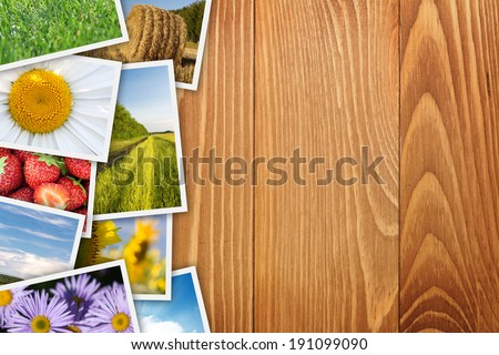 Stack of printed pictures collage on wooden table with copy space for your text or photo
