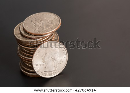 Stack of Quarters on a Black Background
