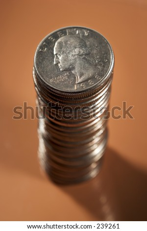 stack of quarters warm background