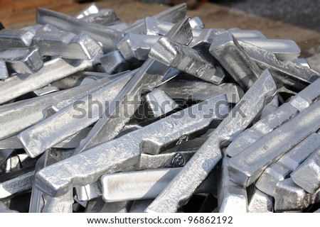 Stack of raw aluminum ingots - stock photo