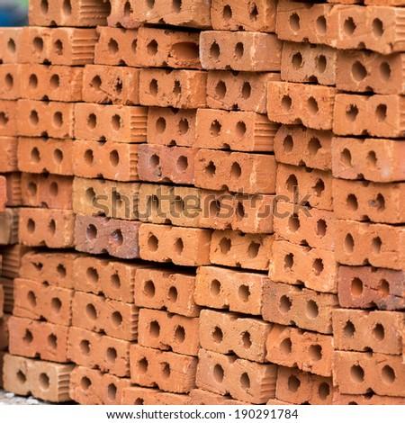 Stack of red bricks - stock photo