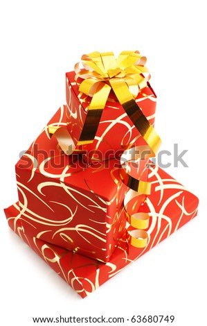Stack of red gifts with golden ornament isolated on white background.
