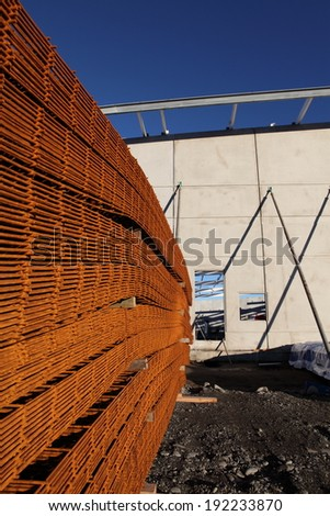 Stack of reinforcing mesh on a building site left out in the weather and rusting.  - stock photo