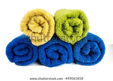 Stack of Rolled up colorful spa Towels isolated on white background - stock photo